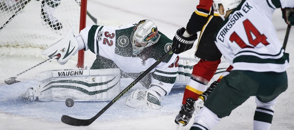 Wild goalie Alex Stalock stretched and stopped the Flames' Michael Frolik in Saturday's victory.