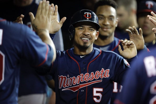 The Twins' Eduardo Escobar is greeted in the dugout after scoring during the fourth inning Thursday.