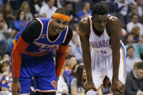 New York Knicks forward Carmelo Anthony (7) smiles at a fan as he waits for a foul shot with Oklahoma City Thunder forward Jerami Grant (9) in the fou