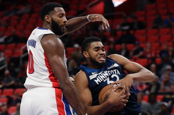 Minnesota Timberwolves forward Anthony Brown (3) grabs a rebound in front of Detroit Pistons center Andre Drummond (0) during the first half of an NBA