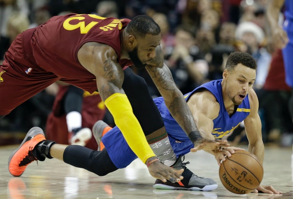 Kyrie Irving is gone to Boston, but LeBron James (left, scrambling for a loose ball against the Warriors Stephen Curry) remains and that will be enoug