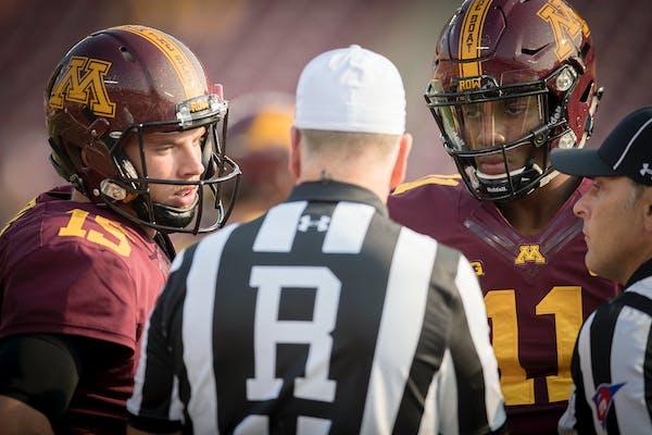 Minnesota's quarterbacks Conor Rhoda, left, and quarterback Demry Croft