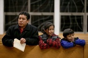 Jacobo Gabriel-Tomas attended a mass with his children in Worthington in 2014. On Tuesday, he crossed the border from Mexico back to Guatemala, leavin