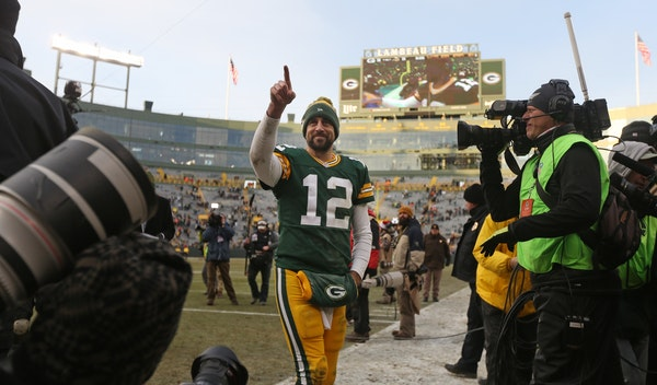 Green Bay Packers quarterback Aaron Rodgers waves to the fans as he left Lambeau Field after a game last season.