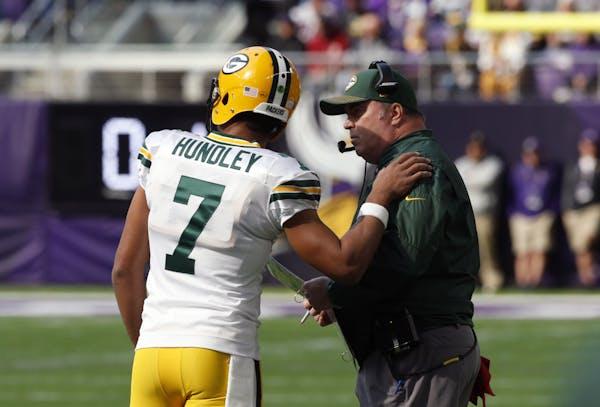 Green Bay Packers quarterback Brett Hundley talks with head coach Mike McCarthy. (AP Photo/Jim Mone, File)