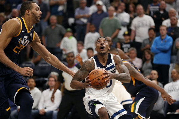 Timberwolves guard Jeff Teague drove to the basket as Jazz center Rudy Gobert defended in the second half Friday.