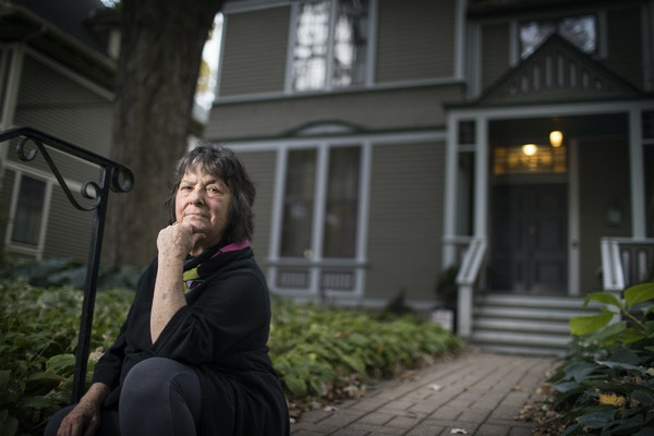 Tess Galati poses outside her home in St. Paul. She rents out part of the house on Airbnb.
