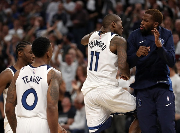 Minnesota Timberwolves guard Jamal Crawford (11) celebrated with his teammates after scoring a three point basket in the final minute of the second ha