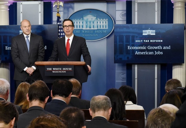 Treasury Secretary Steven Mnuchin, right, and Director of the National Economic Council Gary Cohn discuss the goals and feasibility of President Trump