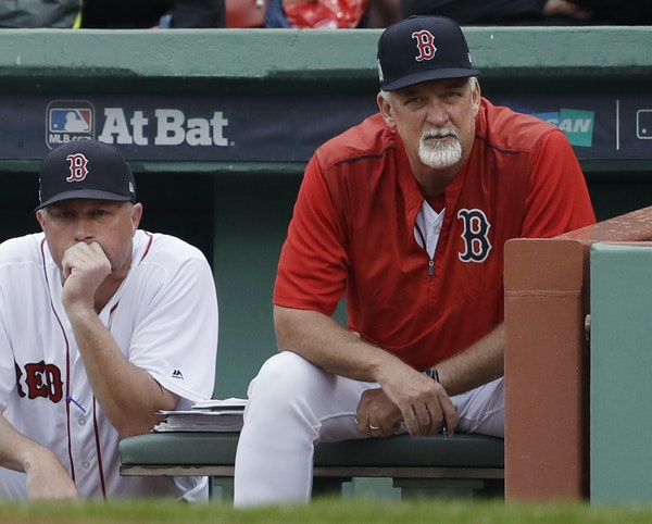 Carl Willis, right, was pitching coach for the AL East champion Red Sox this season.