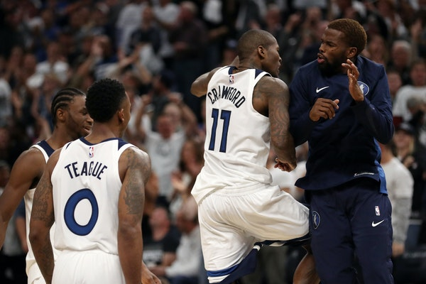 Jamal Crawford celebrated with Aaron Brooks after his go-ahead three-pointer in the final minute for the Timberwolves in their home-opening victory ov