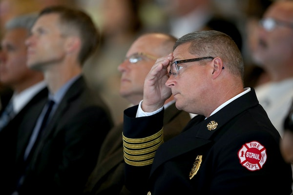 St. Paul Fire Chief Tim Butler listened to St. Paul Mayor Chris Coleman as he gave his final budget address at St. Paul College, Tuesday, August 15, 2