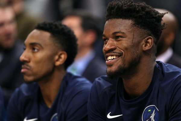 A 7-3 Wolves record sparks a smile in Jimmy Butler, right, who has committed to putting the team first.