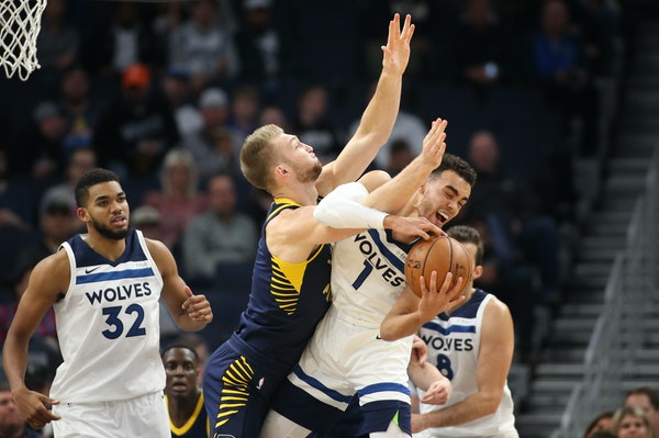 Indiana Pacers forward Domantas Sabonis (11) fouled Minnesota Timberwolves guard Tyus Jones (1) in the first half