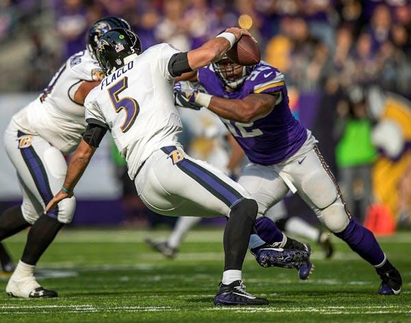 Vikings Tom Johnson closes in on Ravens quarterback Joe Flacco for the sack in the 2nd quarter.