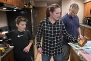 Tina Kill Lenling, son Isaac, 10, and husband Steve Lenling prepared dinner at their St. Paul home. Kill Lenling said the tools she's acquired from