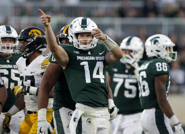 Quarterback Brian Lewerke and the Spartans could hand the Gophers their third consecutive loss Saturday night. (AP photo by Al Goldis)