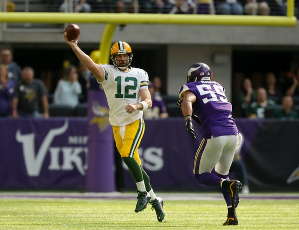 Packers quarterback Aaron Rodgers was tackled just after passing by Vikings linebacker Anthony Barr in the first quarter Sunday and broke his collarbo