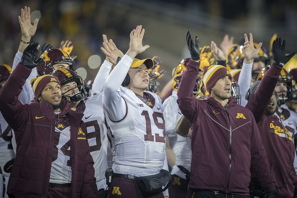 Gophers football players walked onto the field after the first quarter Saturday in Iowa to join the Hawkeyes in waving to children at the University o