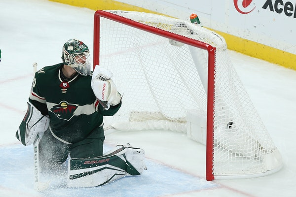 Devan Dubnyk looks back at the puck in the net after the Vancouver Canucks scored a goal in the third period