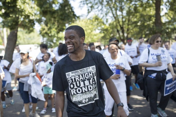St. Paul mayoral candidate Melvin Carter campaigned in July with supporters in the annual Rondo Days parade in St. Paul.