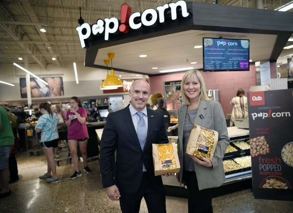 Chad Ferguson, president of Cub's retail west division and Anne Dament, senior vice president of retail of parent company Supervalu Inc., at the popco