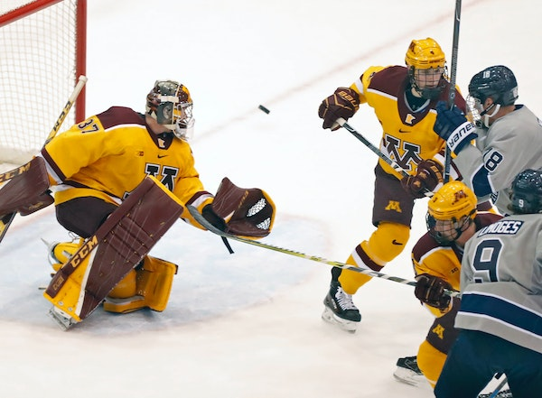 Gophers goalie Eric Schierhorn(37) makes a save.] Sunday afternoon Gophers hockey game, vs. Penn State. at Mariucci 3M Arena.Richard Tsong-Taatarii/Ri