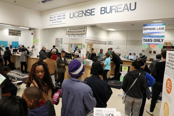 Customers stood in long lines at the department of vehicle services office Friday at the Sears in St. Paul.