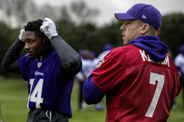 Minnesota Vikings receiver Stefon Diggs (14) and quarterback Case Keenum (7) during practice field at Syon House outside of London in preparation for