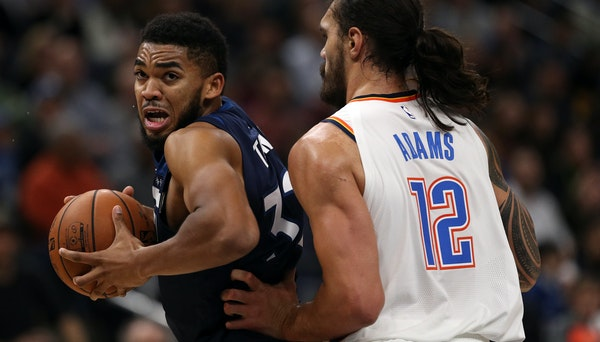 Timberwolves big man Karl-Anthony Towns, left, promises he will play tonight in Miami even though he's not feeling well.