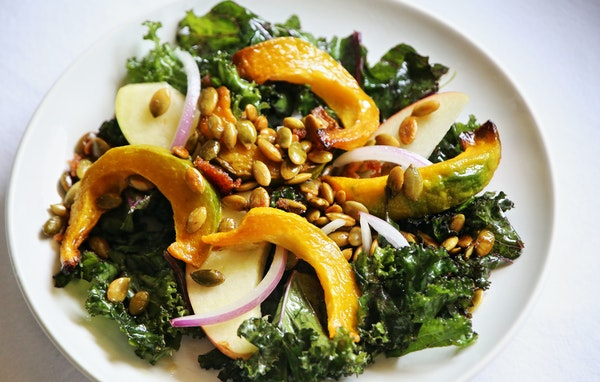 Kale and Roasted Squash Salad With Spiced Pumpkin seeds.
