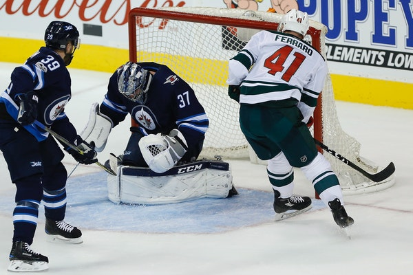 Jets goaltender Connor Hellebuyck stopped a breakaway by the Wild's Landon Ferraro on Friday night.