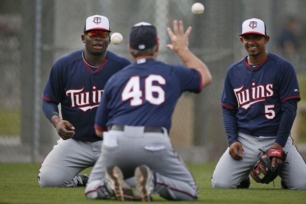Joe Vavra worked with Miguel Sano left and Eduardo Escobar during spring training in 2014.