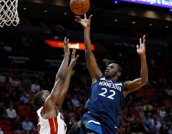 Minnesota Timberwolves guard Andrew Wiggins (22) takes a shot against Miami Heat forward Bam Adebayo during the first half of an NBA basketball game,