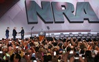 Thousands of NRA members snap photos as Executive Director of the NRA Wayne LaPierre, right, and Executive Director of the NRA Institute for Legislati