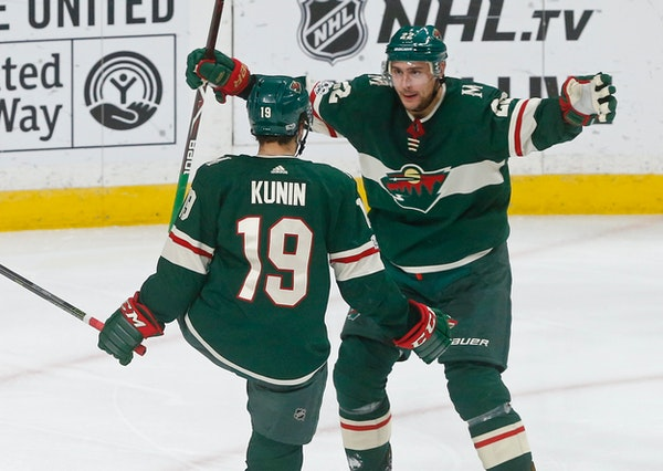 Wild winger Nino Niederreiter, right, celebrated with Luke Kunin after Kunin's goal in the third period off Jets goalie Connor Hellebuyck on Tuesday.