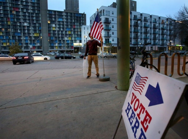 As the polls were about to open for the day at the Brian Coyle Center an election worker who wished to not be identified placed a flag outside the pol