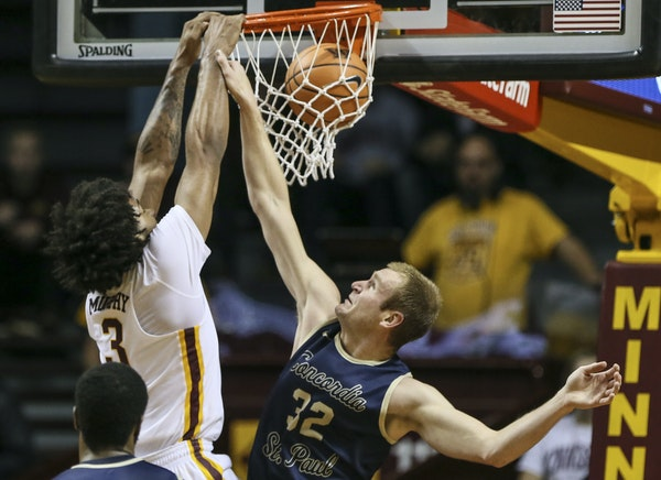 Minnesota's Jordan Murphy (3) dunked the ball during the first half as Concordia's Max Keefe (32) tried to stop him. ] RENEE JONES SCHNEIDER • r