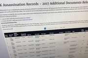 Part of a web page showing the page from the National Archives showing a listing of records released on Thursday, Oct. 26, 2017, in Washington, relati