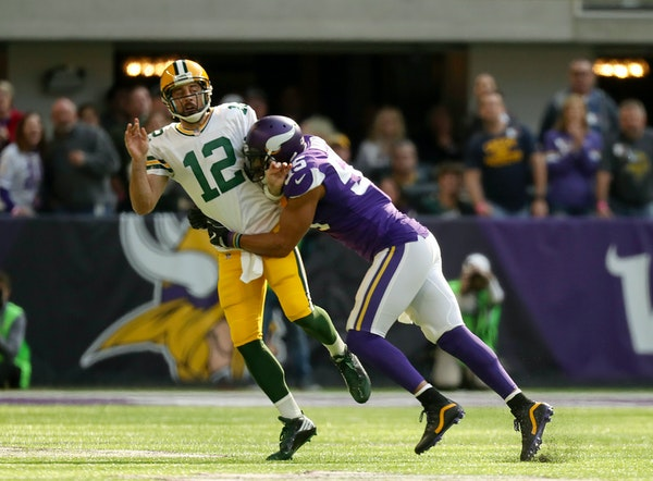 Green Bay Packers quarterback Aaron Rodgers (12) left the game after a hit on this play by Minnesota Vikings outside linebacker Anthony Barr (55) in t
