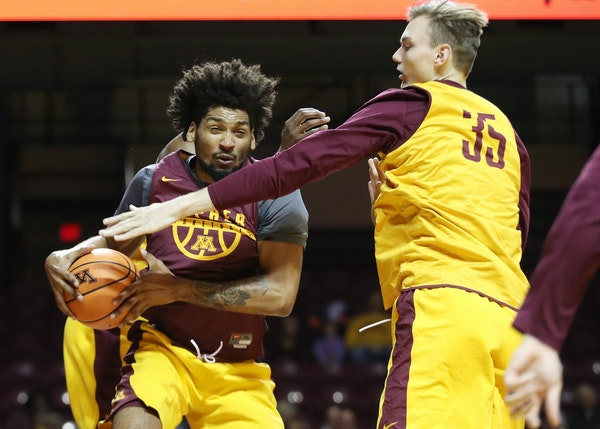 Jordan Murphy pulled down a rebound over Matz Stockman during the University of Minnesota Maroon and Gold Scrimmage at Williams Arena Sunday October 2