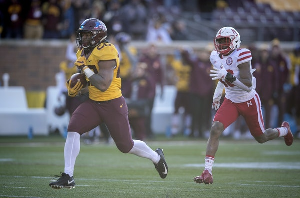 Running back Kobe McCrary broke away for a 43-yard, fourth-quarter touchdown on Saturday, the last of seven touchdowns for the Gophers in their 54-21