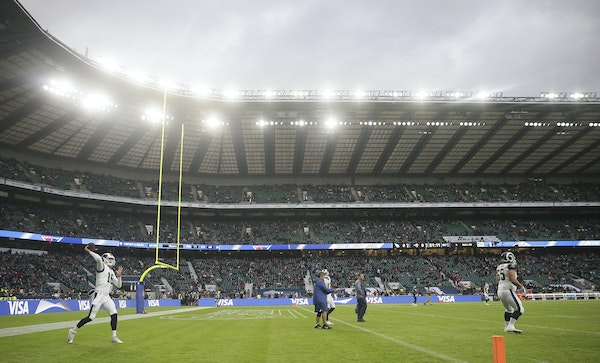Los Angeles Rams quarterback Jared Goff (16) warms up before an NFL football game against Arizona Cardinals at Twickenham Stadium in London, Sunday Oc