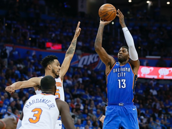 Oklahoma City Thunder forward Paul George (13) shoots over New York Knicks guards Tim Hardaway Jr. (3) and Courtney Lee (5) during the third quarter o