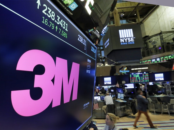The logo for 3M appears on a screen above the trading floor of the New York Stock Exchange, Tuesday, Oct. 24, 2017. Caterpillar and Post-it note maker