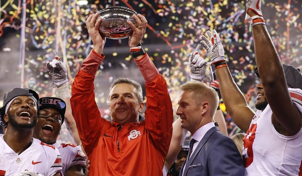 Ohio State Buckeyes head coach Urban Meyer celebrates with his team after their 27-21 Big Ten Champsionship win over the Wisconsin Badgers at Lucas Oi