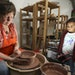 Karin Kraemer, owner of Duluth Pottery, worked on a new piece under the watchful eye of 4-year-old Amaya St. John.