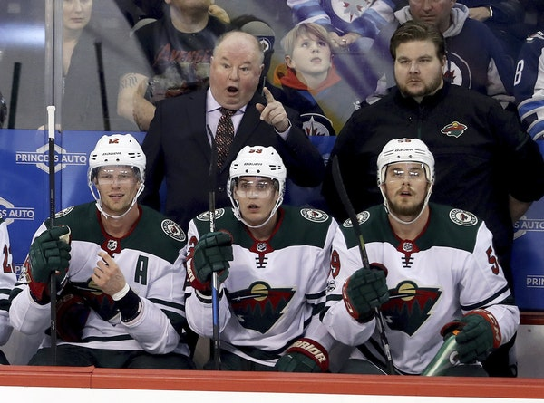 Minnesota Wild's head coach Bruce Boudreau reacts to a referee's call after a disallowed goal during the first period against Winnipeg.