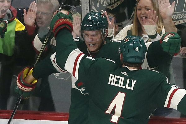 Mikko Koivu drew congratulations from teammate Mike Reilly after his go-ahead goal in the third period.