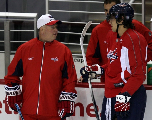 Bruce Boudreau, left, talks with Alex Ovechkin when Boudreau coached the Washington Capitals.